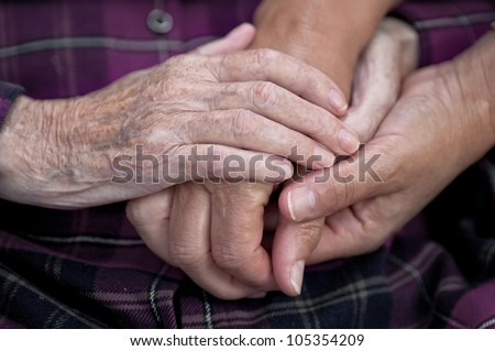 Old and young hands, Hands of the old woman - stock photo