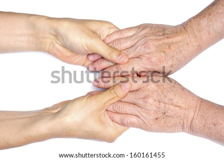 old and young holding hands - stock photo