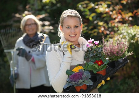 old and young women gardening - stock photo