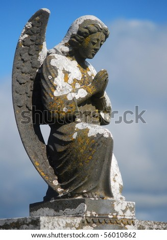 Old Angel Statue - stock photo