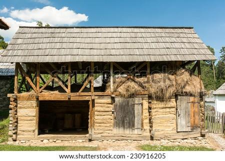 Old Animal Farm Barn In Romanian Village - stock photo