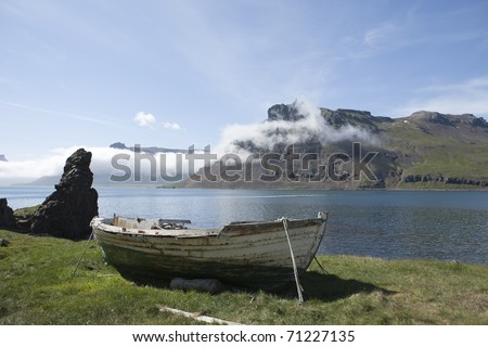 Old Antique boat by seashore - stock photo
