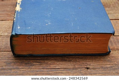 Old antique book on wood background - stock photo