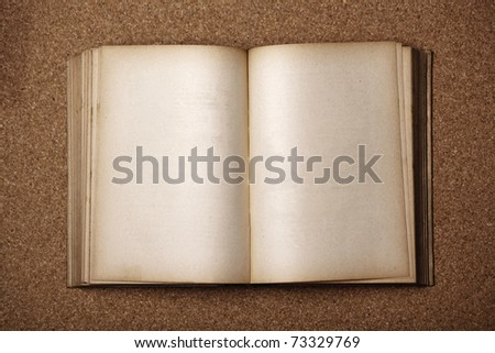 Old Antique Book on wooden table - stock photo