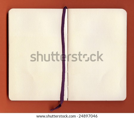 old antique book open on both blank pages - stock photo