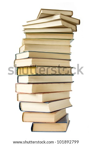 Old antique books pile isolated on white background