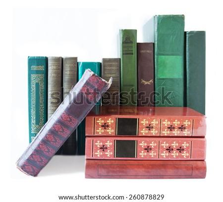 Old antique books shelf isolated on white background - stock photo