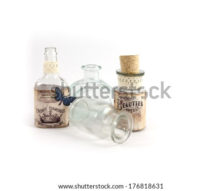 Old antique bottles with labels made from old ads - stock photo