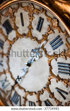 Old antique clock (shallow dof) - stock photo