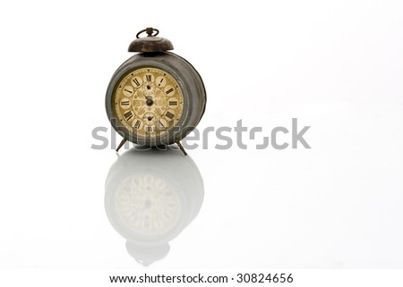 old antique clock with reflection  isolated on white background