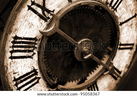 Old Antique Clock With Sepia Tone - stock photo