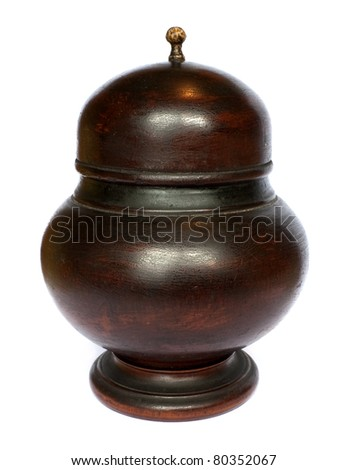 Old antique dark wooden bowl with lid - stock photo