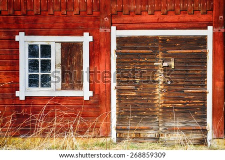 old, antique farm exterior, stained-glass and leaded windows, 17th century nostalgia Sweden - stock photo