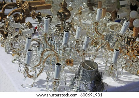Old antique glass chandelier crystal sale stock photo 600691931 old antique glass chandelier and crystal for sale in antiques market aloadofball Image collections