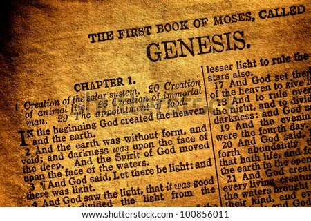 Old antique Holy Bible Christian religion book open to the first page of Moses original chapter of genesis and text about god creation of heaven and hearth in the religious Ancient Testament - stock photo