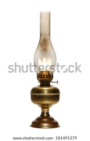 Old antique kerosene oil lantern brass hurricane lamp with hot burning flame casting light in a vintage glass chimney over fuel container metal base isolated on white - stock photo