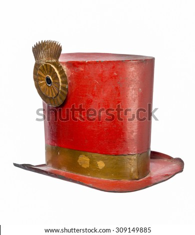 Old antique metal top hat painted red made for circus isolated on white with clip path