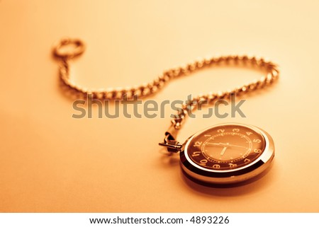 Old antique pocket-watch. Image in rusty-red retro colors - stock photo