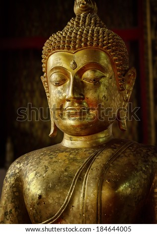Old antique statue of Buddha in a temple room. Thailand, Ayuthaya