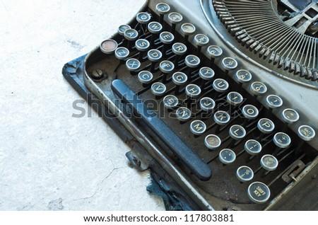 Old Antique typewriter keyboard isolated on white - stock photo