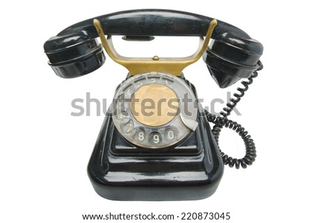 Old antique vintage traditional black phone with disc dials the 19th century isolated on white background  with clipping path. Russia.