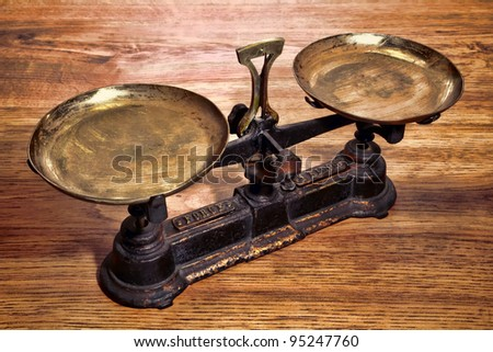 Old Antique weight measuring and kitchen goods weighing solid cast iron scale with brass trays on vintage wood table