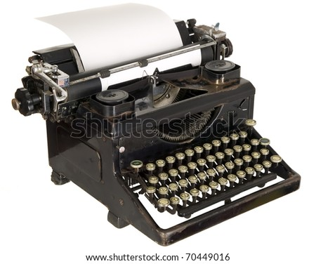 Old antique white typewriter with black keys - stock photo