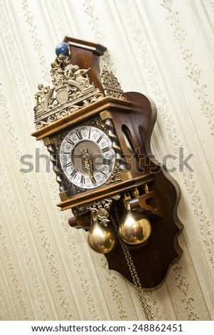 old antique wood clock with carvings for metal hanging on the wall - stock photo