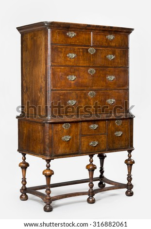 old antique wooden dresser or chest of drawers on stand English European,  isolated on white - stock photo