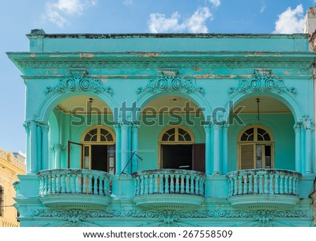 Old apartment building with round balconies - stock photo