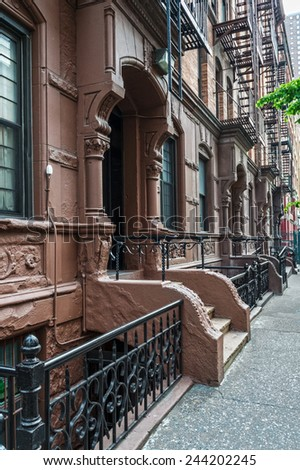 Old apartment buildings with fire escapes on the West side of Manhattan. - stock photo