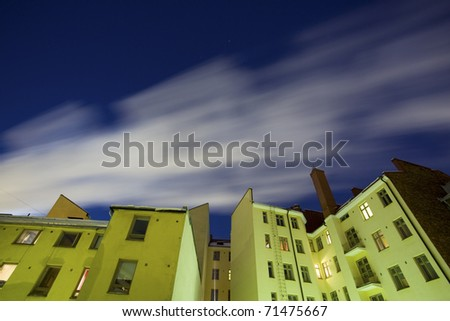 Old apartment house at evening - stock photo