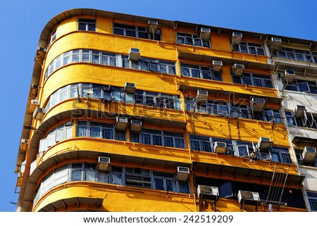 Old apartments in Hong Kong downtown at day - stock photo