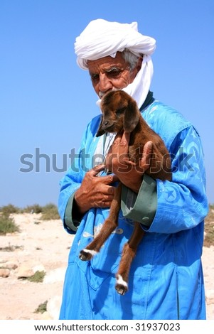 old arabian bedouin with goat