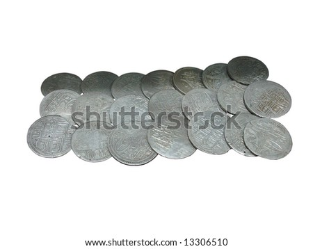 Old Arabian silver coins isolated over white background - stock photo