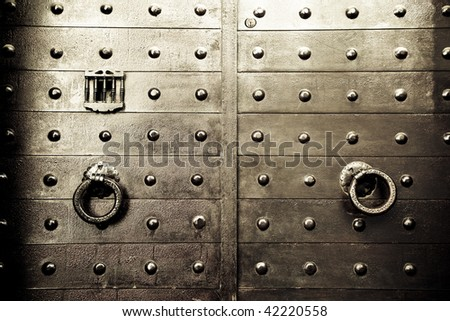 Old arabic styled iron door. - stock photo