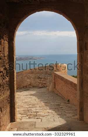 Old arc with view to sea