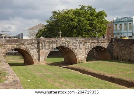 Old arched stone bridge  - stock photo