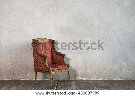 Old armchair in a concrete room