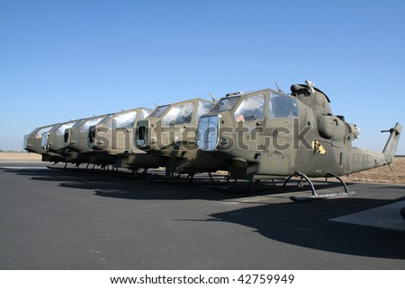 Old army Cobra helicopters cannibalized - stock photo