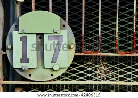 Old Army vehicle identification plate. License plate number seventeen. - stock photo