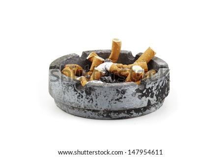 old ashtray full of cigarettes - stock photo