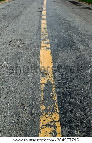 Old asphalt road background - stock photo
