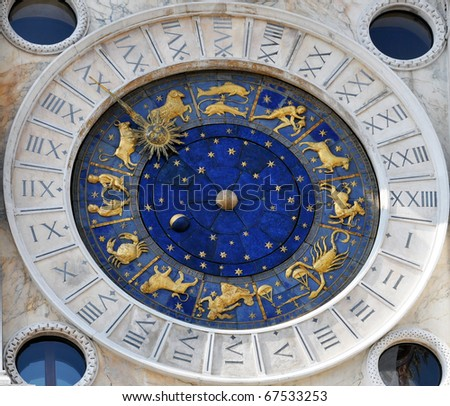 Old astronomical clock with zodiac signs and moon phase - stock photo