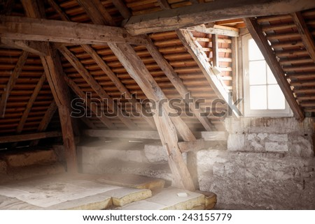 Old attic of an ancient house - stock photo