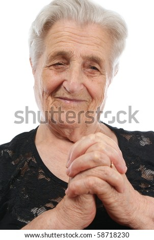 Old, attractive Caucasian woman praying - stock photo
