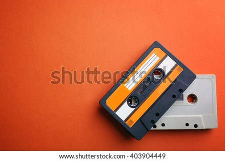 Old audio cassettes on red background - stock photo