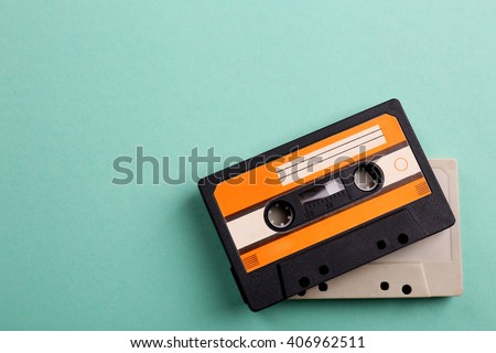 Old audio cassettes on turquoise  background - stock photo