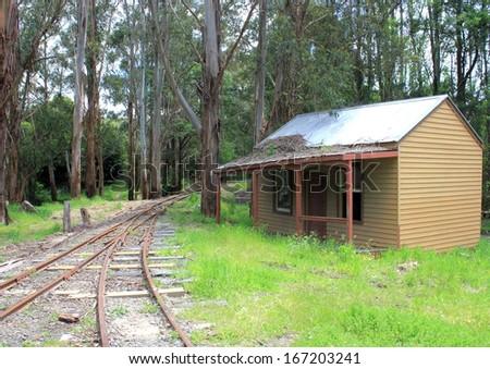 Old Australian settlers homestead near railway tracks - stock photo