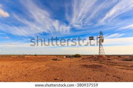 old Australian windmill during drought in outback Queensland, Australia - stock photo